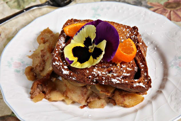 An appetizing breakfast of French Toast decorated with a delicate flower.