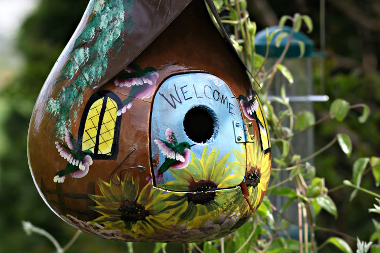 A nicely crafted gourd giving  warm welcome to all who pass by.