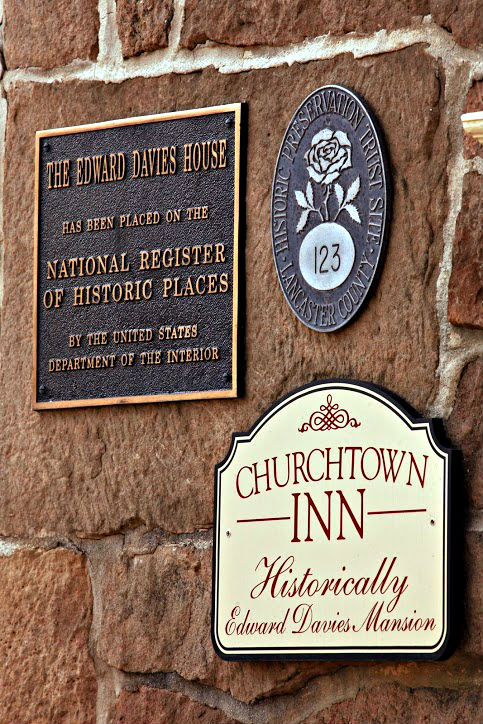 A view of the historical signs which decorate the front of the Inn.