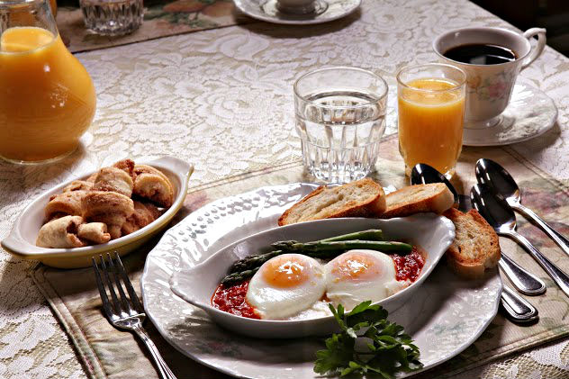 An example of the breakfast choices like poached eggs and hot coffee.
