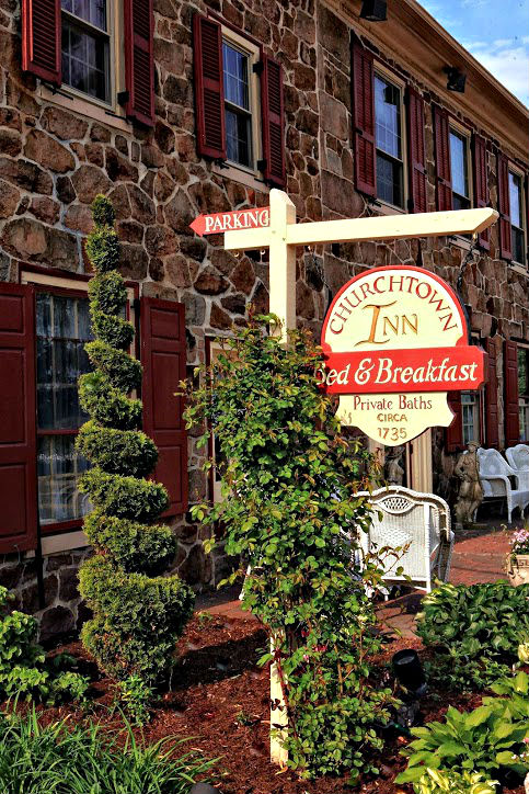 A view of the front of the Inn with the welcoming sign.