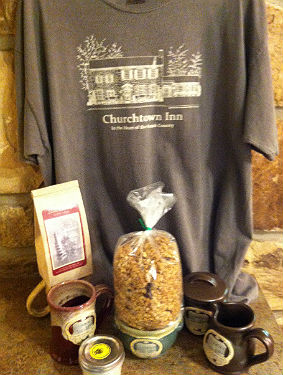 churchtown inn merchandice including granola, coffee mugs, and a grey t-shirt.